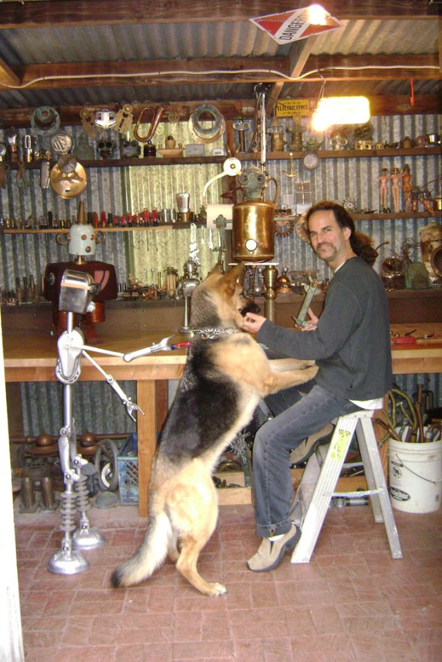 Tal and his German Shepard Mancha in the workshop