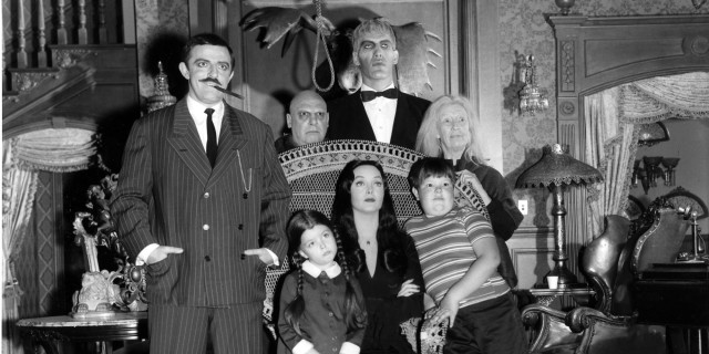 "UNITED STATES - SEPTEMBER 18: THE ADDAMS FAMILY - Pilot - Season One - 9/18/64, ""The Addams Family"" was based on the characters in Charles Addams' ""New Yorker"" cartoons. The wealthy Gomez Addams (John Astin, left) was madly in love with his wife, Morticia (Carolyn Jones, seated), and their two children, Wednesday (Lisa Loring) and Pugsley (Ken Weatherwax). The family, including Uncle Fester (Jackie Coogan), their towering butler Lurch (Ted Cassidy), Grandmama (Blossom Rock), and Thing, a hand that usually appeared out of a small wooden box, resided in an ornate, gloomy mansion., (Photo by ABC Photo Archives/ABC via Getty Images)"