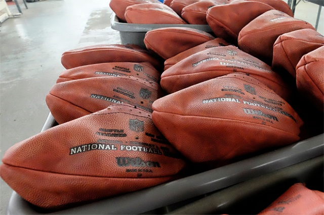 Official game balls for NFL football's Super Bowl XLIX sit in a bin before being laced and inflated at the Wilson Sporting Goods Co. in Ada, Ohio, Tuesday, Jan. 20, 2015. The New England Patriots will play the Seattle Seahawks for the NFL championship on Sunday, Feb. 1, 2015, in Glendale, Ariz. (AP Photo/Rick Osentoski)